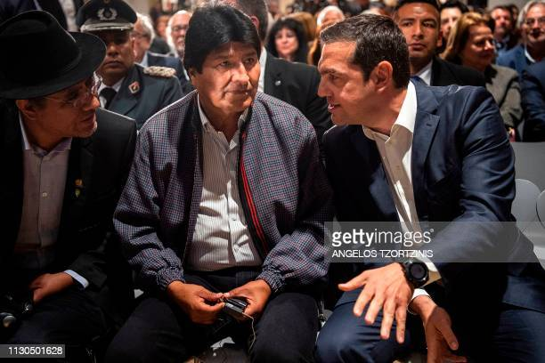 Bolivian President Evo Morales speaks with Greek Prime Minister Alexis Tsipras during a conference at the Stavros Niarchos Foundation Cultural Center...