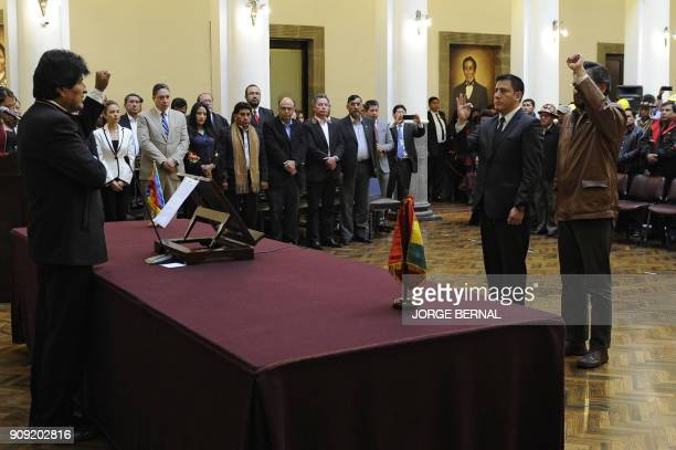 Bolivian President Evo Morales swears in his new minister of defense Javier Zabaleta and minister of the presidency Alfredo Rada during a ceremony to...