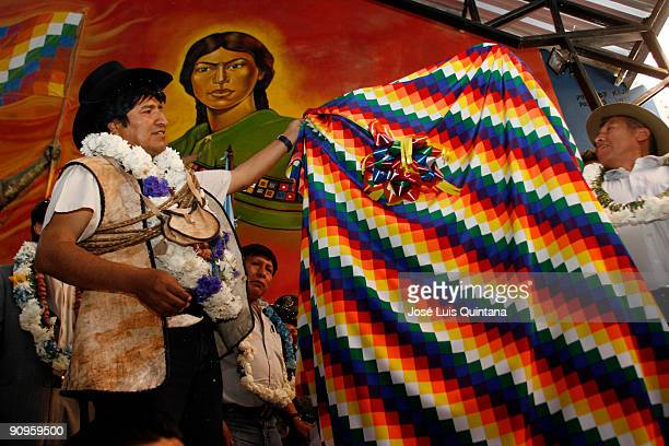 Bolivian President Evo Morales takes the wiphala off the commemorative plaque in honour of the new Bolivian Rural Workers Union's headquarters on...
