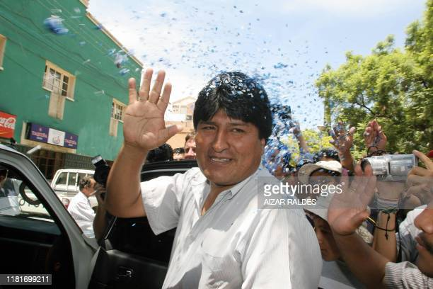 Bolivian presidential candidate Evo Morales Ayma waves to supporters 19 December 2005 in Cochabamba Bolivia Supporters danced in the streets after...