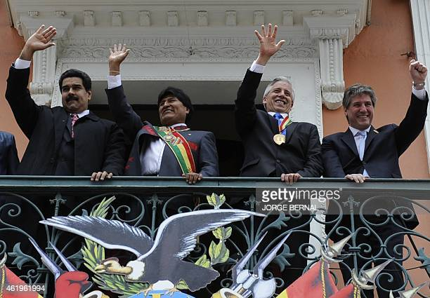 Bolivian reelected President Evo Morales and VicePresident Alvaro Garcia Linera gesture at the crowd next to Venezuela's President Nicolas Maduro and...