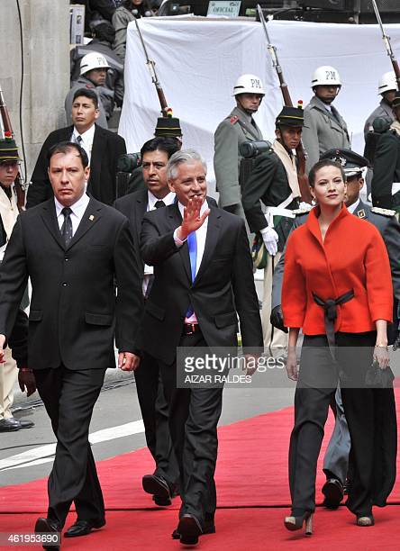 Bolivian reelected VicePresident Alvaro Garcia Linera accompanied by his wife Claudia Fernandez heads to the National Congress to be sworn in for a...