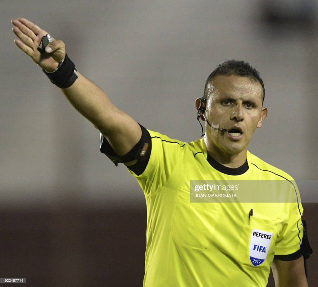 Bolivian referee Gery Vargas gestures during the Copa Sudamericana 2018 first stage football match between Argentina's Lanus and Peru's Sporting Cristal at 'La Fortaleza' stadium in Lanus, Buenos Aires, Argentina, on February 21, 2018. /