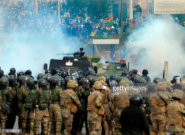 Bolivian riot police and soldiers clash with supporters of Bolivia's ex-President Evo Morales during a protest against the interim government in...