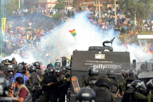 Bolivian riot police clash with supporters of Bolivia's ex-President Evo Morales during a protest against the interim government, in Sacaba, Chapare...