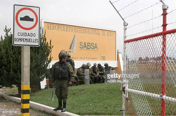 Bolivian riot police stand guard 30 March 2006 at the entrance of El Alto international airport close to La Paz Police and army troops are guarding...
