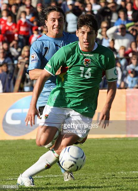 Bolivian Ronald Raldes dribbles past Uruguayan Cristian Rodriguez during their FIFA World Cup South Africa2010 qualifying match in Montevideo 13...