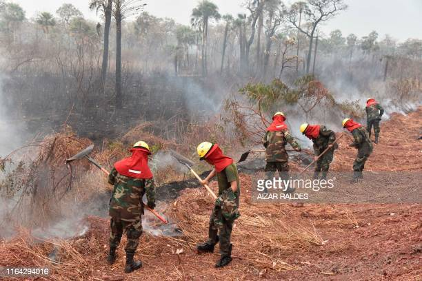 Bolivian soldiers combat forest fires in Otuquis National Park in the Pantanal ecoregion of Bolivia southeast of the Amazon basin on August 26 2019...