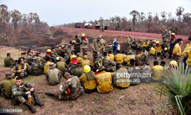 TOPSHOT Bolivian soldiers rest after combating forest fires in Otuquis National Park in the Pantanal ecoregion of Bolivia southeast of the Amazon...