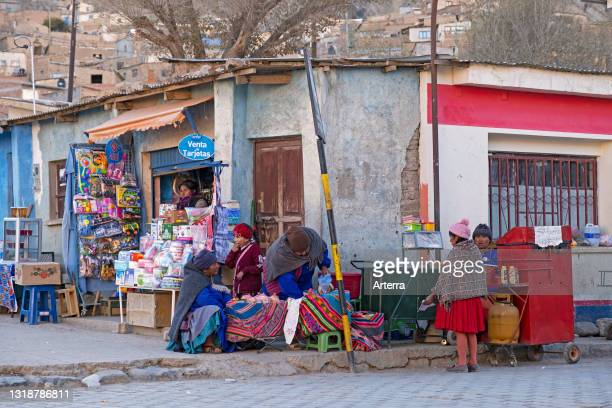 Bolivian street vendors and little shop in the village Atocha in the Andes, Sud Chichas Province, Potosí Department, Bolivia.