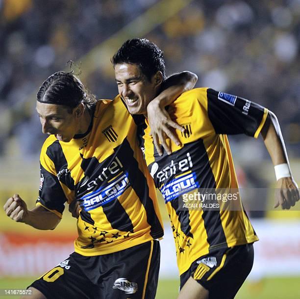 Bolivian The Strongest's Rodrigo Ramallo and Pablo Escobar celebrate a goal against Brazilian Internacional during the Copa Libertadores football...
