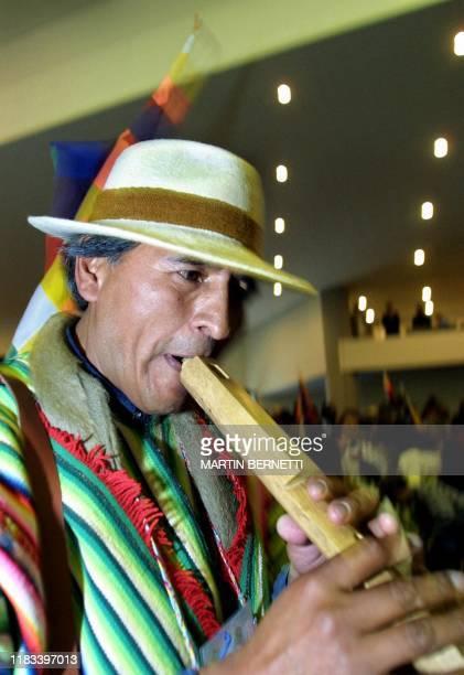 Bolivian Tomas Huanaqu enters an indigenous summit in Quito, Ecuador 17 September 2002. El indígena boliviano Tomas Huanaqu hace su entrada a la...