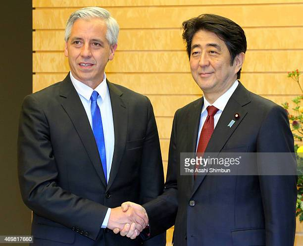 Bolivian Vice President Alvaro Garcia Linera and Japanese Prime Minister Shinzo Abe shake hands prior to their meeting at Abe's official residence on...