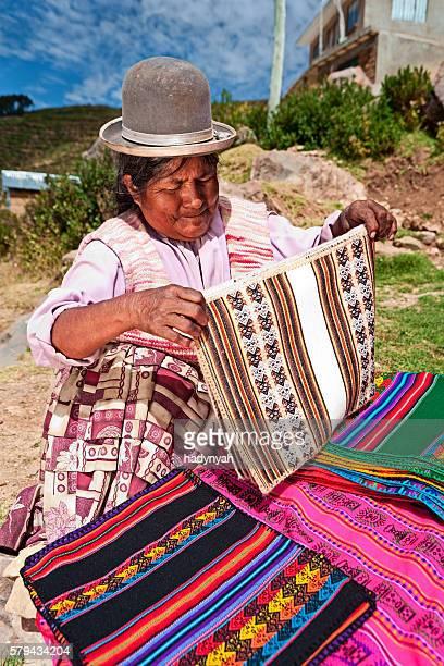 Bolivian woman selling souvenirs, Isla del Sol, Bolivia