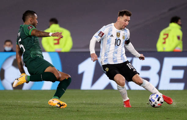 Bolivia's Adrian Jusino and Argentina's Lionel Messi vie for the ball during their South American qualification football match for the FIFA World Cup...