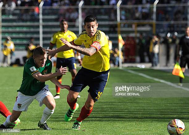 Bolivia's Alejandro Chumacero and Colombia's James Rodriguez vie for the ball during their Russia 2018 FIFA World Cup South American Qualifiers'...