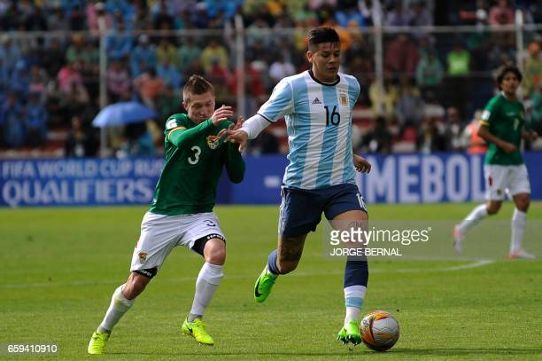 Bolivia's Alejandro Chumacero vies for the ball with Argentina's Marcos Rojo during their 2018 FIFA World Cup qualifier football match in La Paz on...