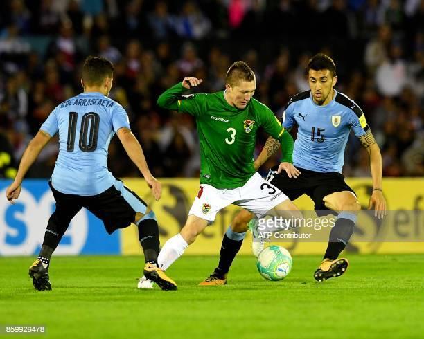 Bolivia's Alejandro Chumacero vies for the ball with Uruguay's Matias Vecino and Giorgian De Arrascaeta during their 2018 World Cup football...