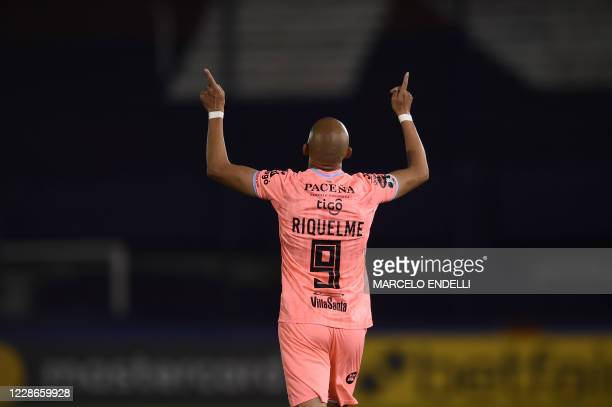 Bolivia's Bolivar Argentine Marcos Riquelme celebrates after scoring against Argentina's Tigre during their closed-door Copa Libertadores group phase...