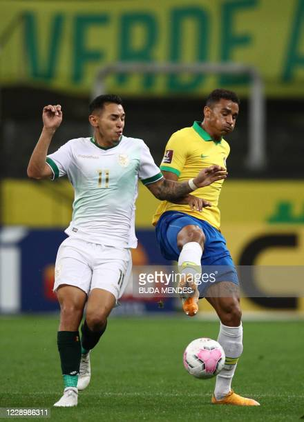 Bolivia's Bruno Miranda and Brazil's Danilo vie for the ball during their 2022 FIFA World Cup South American qualifier football match at the Neo...