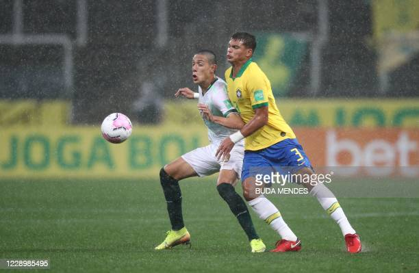 Bolivia's Cesar Menacho and Brazil's Thiago Silva vie for the ball during their 2022 FIFA World Cup South American qualifier football match at the...