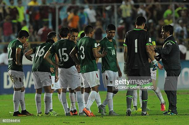 Bolivia's coach Angel Guillermo Hoyos talks to his players after losing their WC 2018 qualifier football match against Venezuela in Maturin Venezuela...