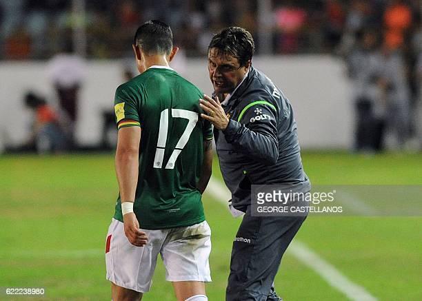 Bolivia's coach Angel Guillermo Hoyos talks to Marvin Bejarano during their WC 2018 qualifier football match against Venezuela in Maturin Venezuela...