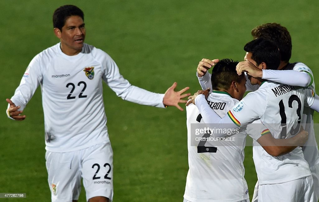 Bolivia's defender Edward Zenteno (L) Bolivia's defender Miguel Angel Hurtado (C) and Bolivia's midfielder Damir Miranda (C R) celebrate with teammates after their 2015 Copa America football championship match against Ecuador, in Valparaiso, Chile, on June 15, 2015. Bolivia won the match 3 - 2.
