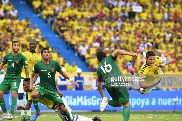 TOPSHOT Bolivia's defenders Ronald Raldes Mario Cuellar and Cristian Coimbra vie for the ball with Colombia's midfielder James Rodriguez during their...