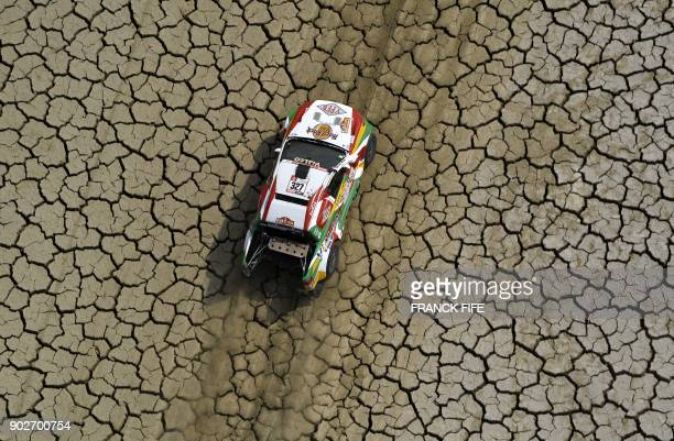 TOPSHOT Bolivia's driver Marco Bulacia and his codriver Eugenio Arrieta steer their Ford during Stage 3 of the Dakar 2018 between Pisco and San Juan...