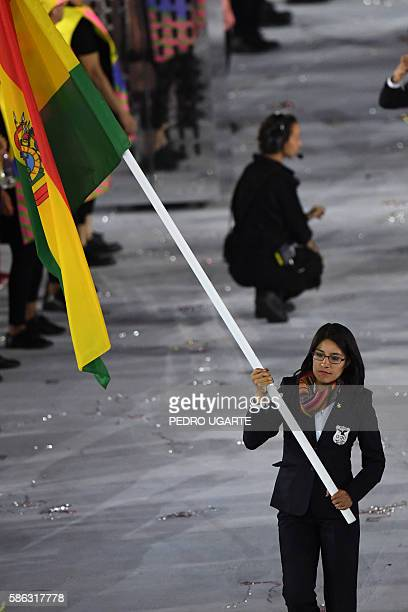 Bolivia's flagbearer Angela Castro leads her delegation during the opening ceremony of the Rio 2016 Olympic Games at the Maracana stadium in Rio de...