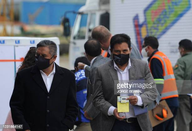 Bolivia's Foreign Minister Rogelio Mayta and Health Minister Jeyson Auza are seen after the arrival of a shipment of 228,000 doses of the...