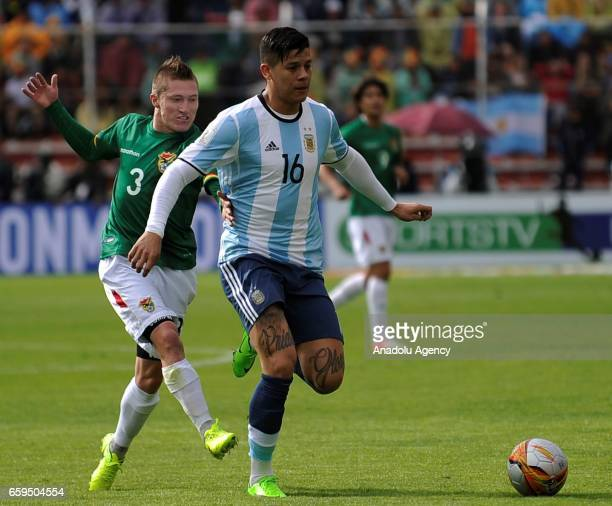 Bolivia's forward Alejandro Chumacero vies for the ball with Argentina's Marcos Rojos during the 2018 FIFA World Cup qualifier football match between...