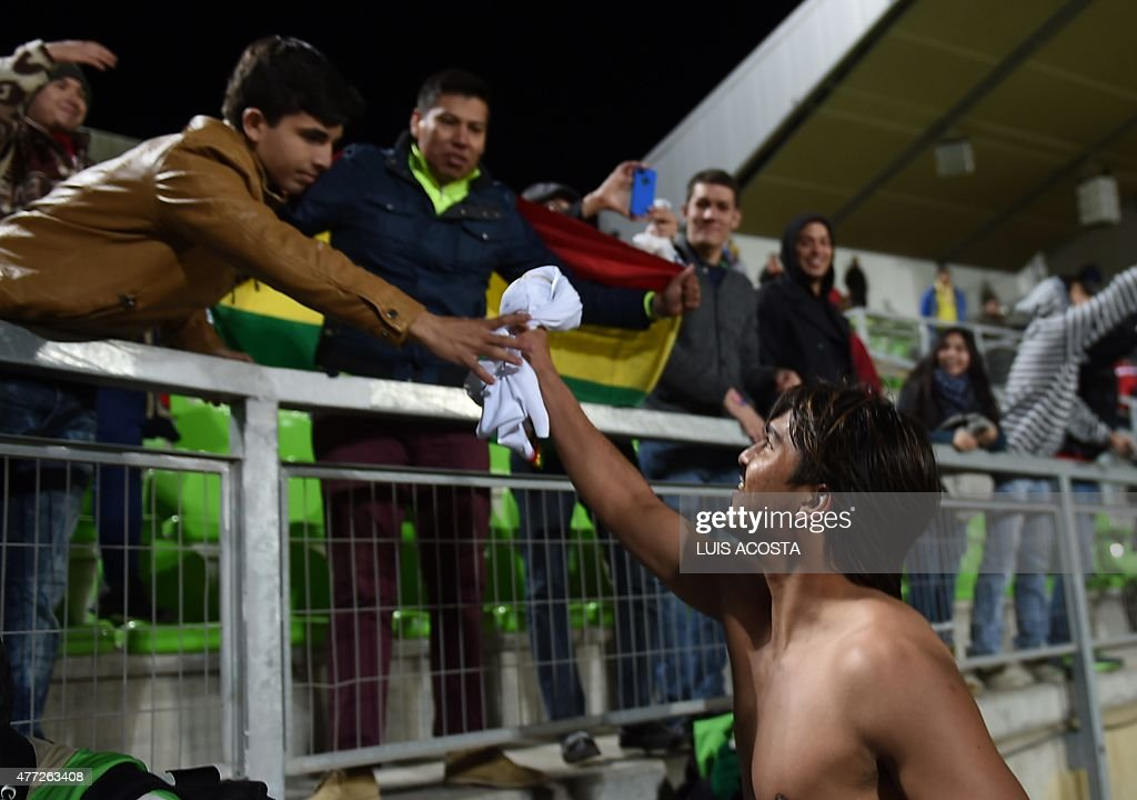 Bolivia's forward Marcelo Martins (R) gives his jersey to a fan after their 2015 Copa America football championship match against Ecuador, in Valparaiso, Chile, on June 15, 2015. Bolivia won the match 3 - 2.