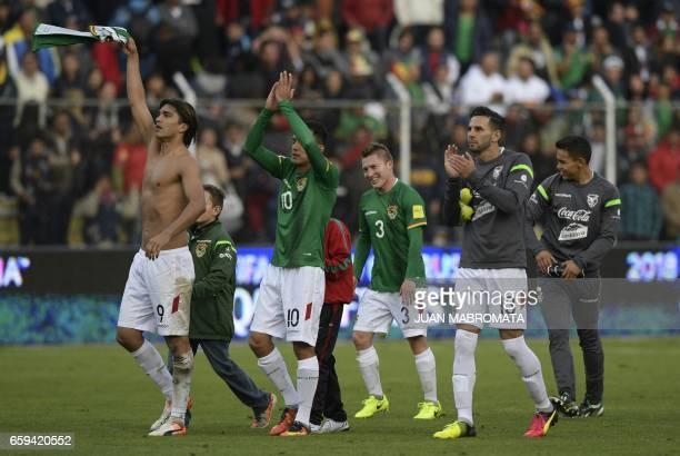 Bolivia's forward Marcelo Martins Jhasmany Campos Alejandro Chumacero and Bolivia's defender Alejandro Melean celebrate after defeating Argentina...