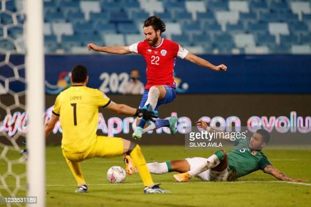 Bolivia's goalkeeper Carlos Lampe blocks the goal as Bolivia's Adrian Jusino marks Chile's Ben Brereton during their Conmebol Copa America 2021...