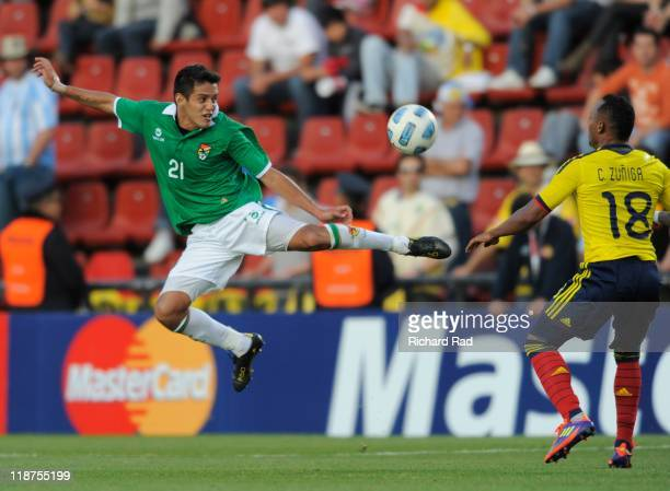 Bolivia's Jhasmani Campos struggle for the ball with Juan Zuniga of Colombia during 2011 Copa America soccer match as part of Group A at Brigadier...