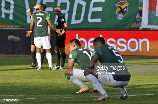 Bolivia's Leonel Justiniano and teammate Adrian Jusino react at the end of their closed-door 2022 FIFA World Cup South American qualifier football...