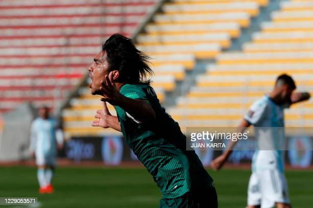 Bolivia's Marcelo Martins celebrates after scoring against Argentina during their 2022 FIFA World Cup South American qualifier football match at the...