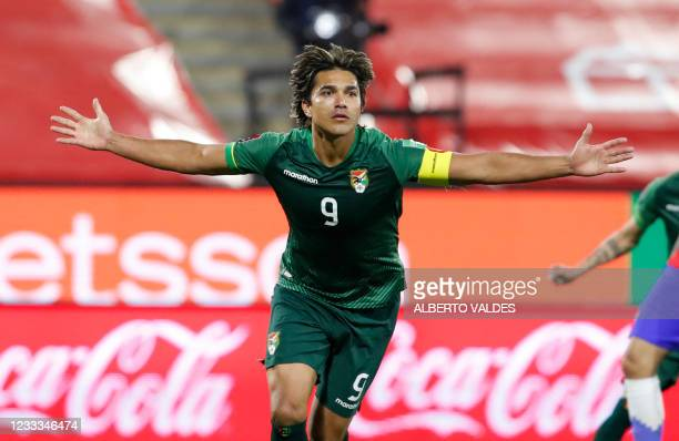 Bolivia's Marcelo Martins celebrates after scoring against Chile during their South American qualification football match for the FIFA World Cup...