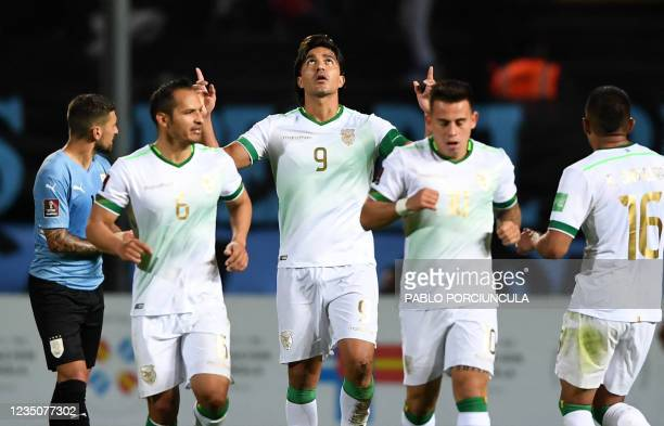 Bolivia's Marcelo Martins celebrates after scoring against Uruguay during the South American qualification football match for the FIFA World Cup...