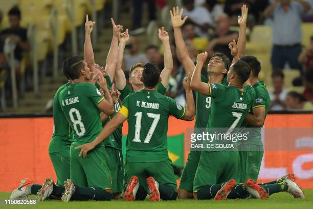 TOPSHOT Bolivia's Marcelo Martins celebrates with teammates after scoring a penalty against Peru during their Copa America football tournament group...