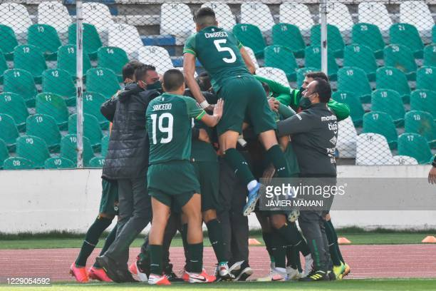 Bolivia's Marcelo Martins celebrates with teammates after scoring against Argentina during their 2022 FIFA World Cup South American qualifier...