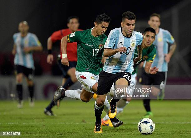 Bolivia's Marvin Bejarano and Argentina's Angel Correa vie for the ball during their Russia 2018 FIFA World Cup South American Qualifiers' football...