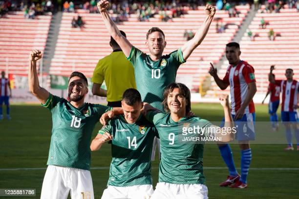 Bolivia's Moises Villaroel celebrates with teammates after scoring against Paraguay during their South American qualification football match for the...