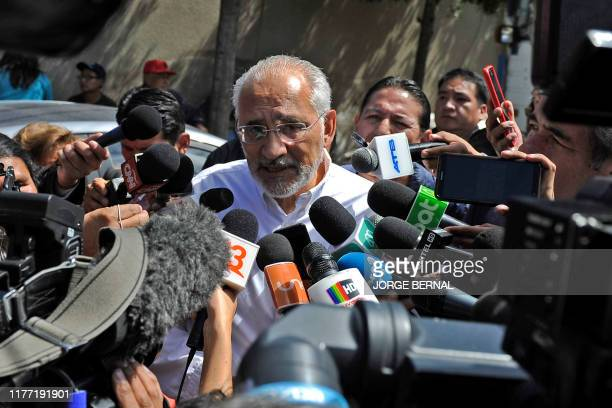 Bolivias opposition presidential candidate for 'Comunidad Ciudadana' party former president Carlos Mesa talks to the press after casting his vote...