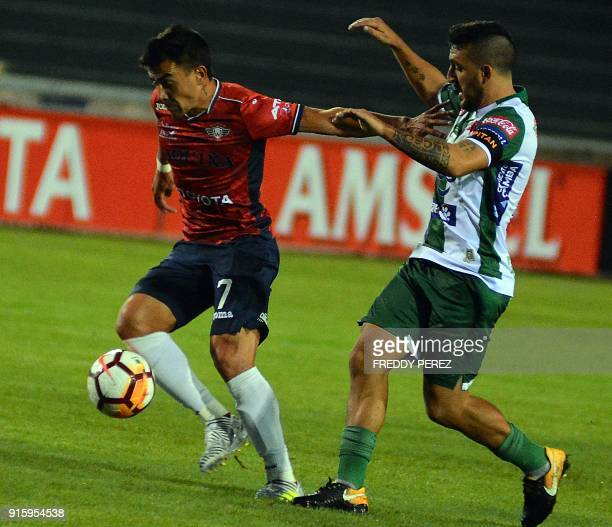 Bolivia's Oriente Petrolero player Marcel Roman vies for the ball with Bolivia's Wilstermann player Marcelo Bergese during their Copa Libertadores...