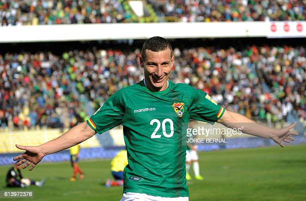 Bolivia's Pablo Escobar celebrates after scoring against Brazil during their Russia 2018 World Cup football qualifier match in Natal, Brazil, on...