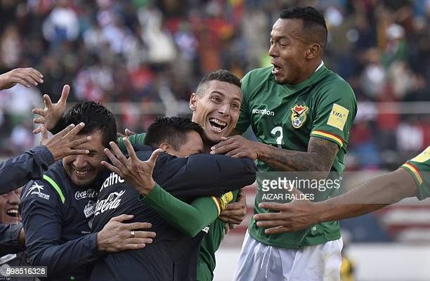 Bolivia's Pablo Escobar celebrates with Bolivia's defender Edemir Rodriguez after scoring against Peru during the Russia 2018 World Cup qualifier...