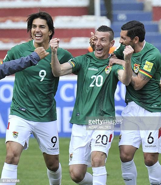 Bolivia's Pablo Escobar celebrates with Marcelo Martins and Walter Flores after scoring against Ecuador during their Russia 2018 FIFA World Cup...